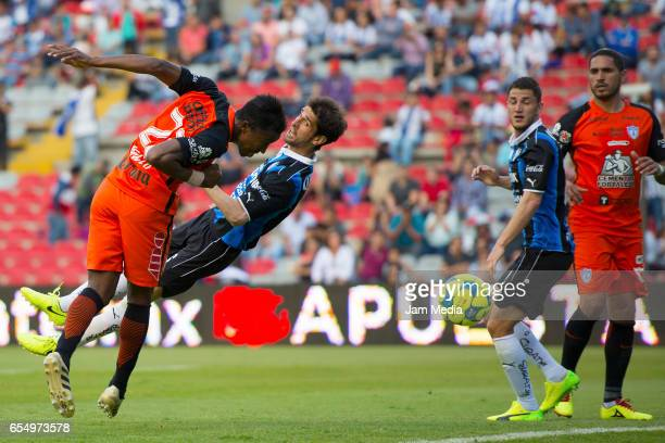 Oscar Murillo of Pachuca heads the ball during the 11th round match between Queretaro and Pachuca as part of the Torneo Clausura 2017 Liga MX at...