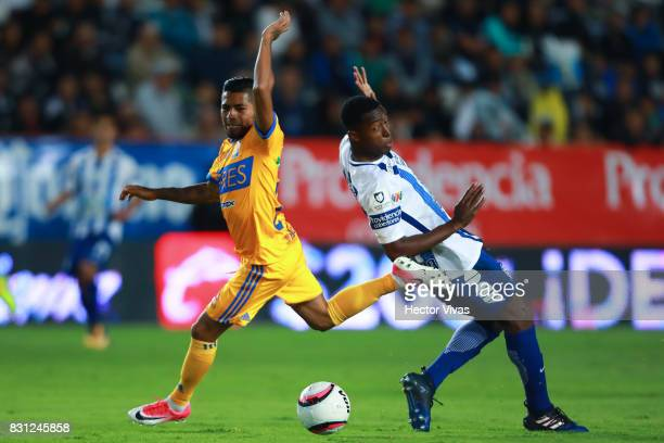 Oscar Murillo of Pachuca struggles for the ball with Javier Aquino of Tigres during the 4th round match between Pachuca and Tigres UANL as part of...