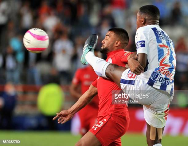 Oscar Murillo of Pachuca vies for the ball with Pedro Canelo of Toluca during their Mexican Apertura tournament football match at the Hidalgo stadium...
