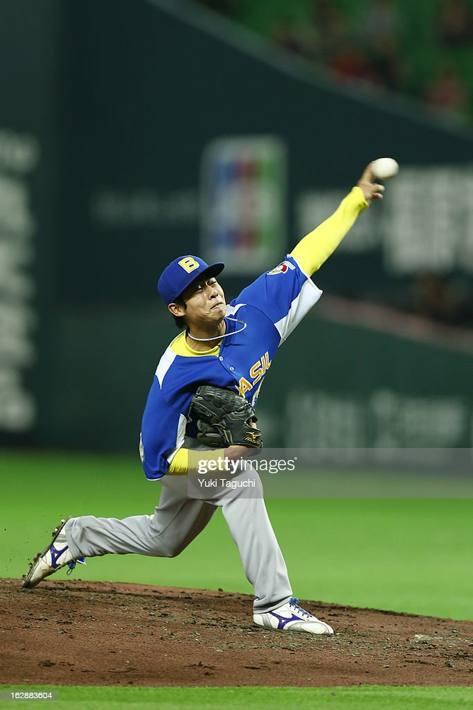 Oscar Nakaoshi #14 of Team Brazil pitches during the World Baseball Classic exhibition game against the SoftBank Hawks at the Fukuoka Yahoo! Japan Dome on Thursday, February 28, 2013 in Fukuoka, Japan.
