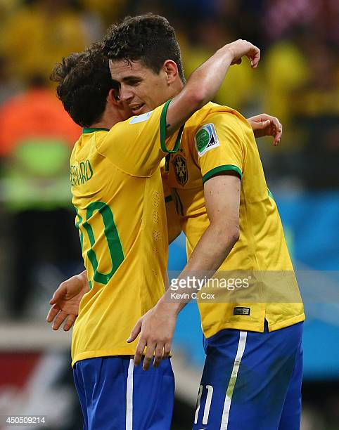 Oscar of Brazil celebrates his goal in the second half with Bernard during the 2014 FIFA World Cup Brazil Group A match between Brazil and Croatia at...