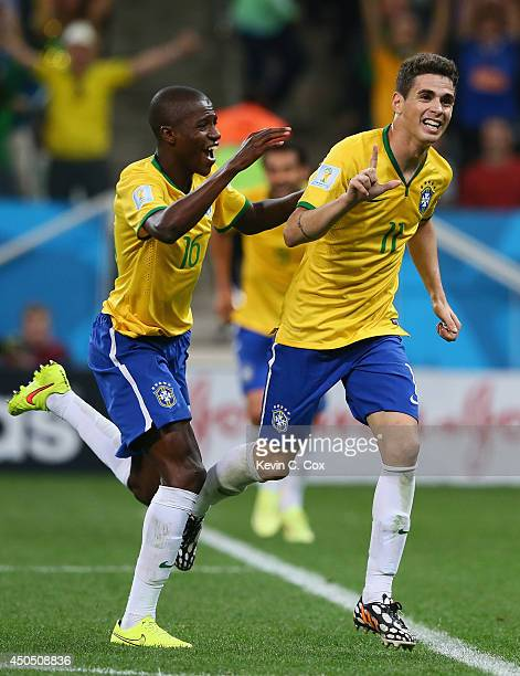 Oscar of Brazil celebrates his second half goal with Ramires during the 2014 FIFA World Cup Brazil Group A match between Brazil and Croatia at Arena...