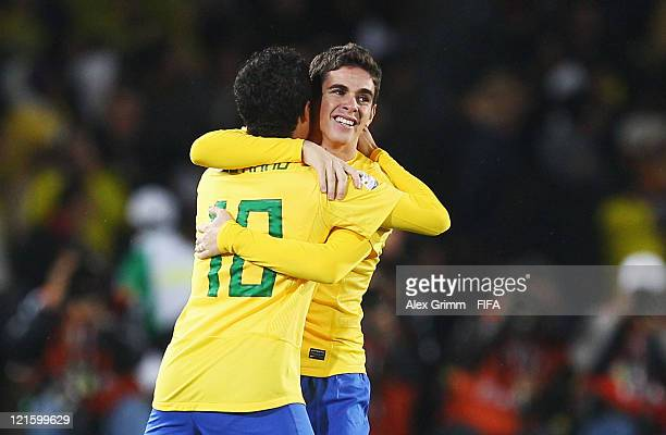 Oscar of Brazil celebrates his team's first goal with team mate Philippe Coutinho during the FIFA U20 World Cup 2011 final between Brazil and...