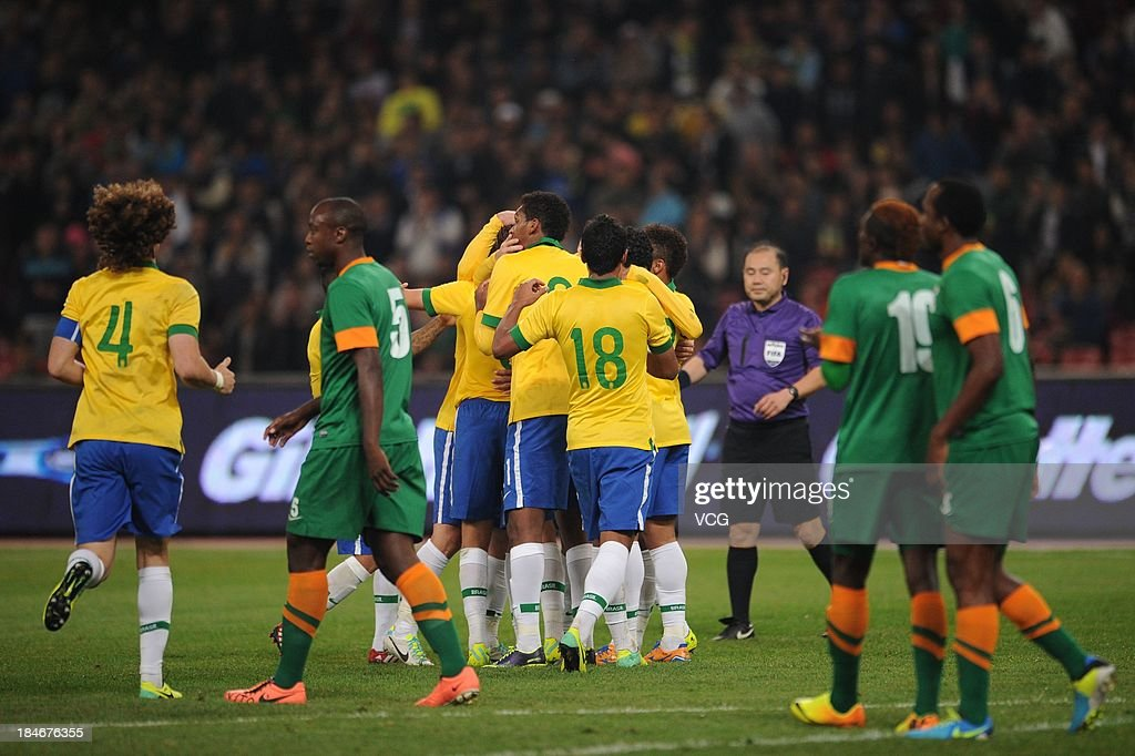 Oscar #11 of Brazil celebrates with team mates after scoring his team's first goal during the international friendly match between Brazil and Zambia at Beijing National Stadium on October 15, 2013 in Beijing, China.