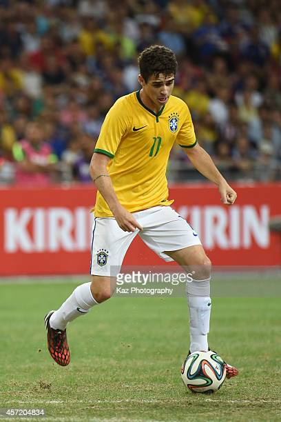 Oscar of Brazil dribbles the ball during the international friendly match between Japan and Brazil at the National Stadium on October 14 2014 in...