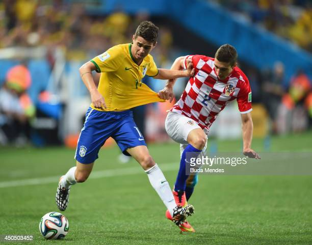 Oscar of Brazil fights off Sime Vrsaljko of Croatia in the first half during the 2014 FIFA World Cup Brazil Group A match between Brazil and Croatia...