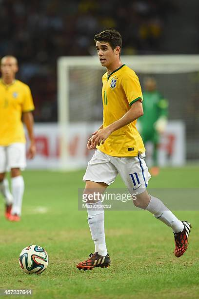 Oscar of Brazil in action during the international friendly match between Japan and Brazil at the National Stadium on October 14 2014 in Singapore