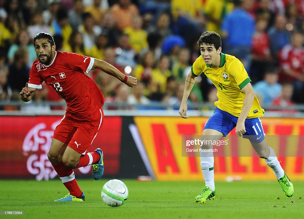 Oscar of Brazil (R) is challenged by Ricardo Rodriguez of Switzerland during the international friendly match between Switzerland and Brazil at St. Jakob Stadium on August 14, 2013 in Basel, Switzerland.