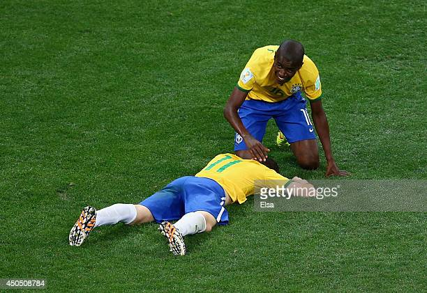 Oscar of Brazil lies on the ground celebrating his goal with Ramires in the second half during the 2014 FIFA World Cup Brazil Group A match between...
