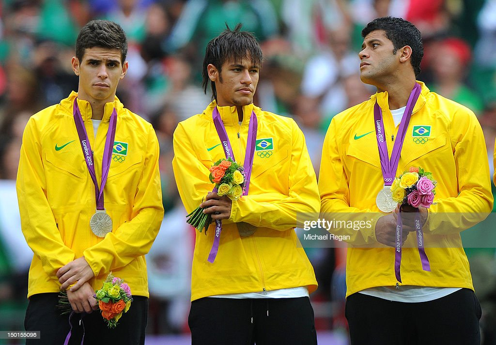 Oscar of Brazil, Neymar of Brazil and Hulk of Brazil look on with their silver medals during the medal ceremony for the Men's Football Final between Brazil and Mexico on Day 15 of the London 2012 Olympic Games at Wembley Stadium on August 11, 2012 in London, England.