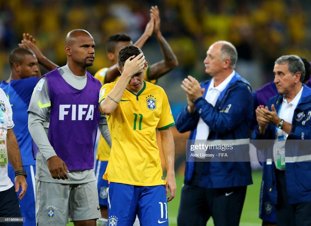 Oscar of Brazil shows his dejection after the 1-7 defeat in the 2014 FIFA World Cup Brazil Semi Final match between Brazil and Germany at Estadio Mineirao on July 8, 2014 in Belo Horizonte, Brazil.