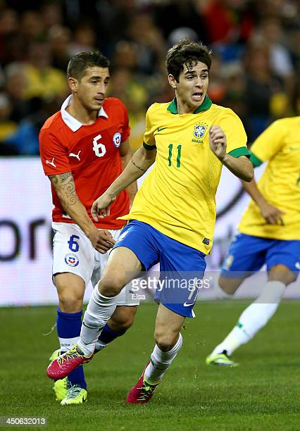Oscar of Brazil takes the ball as Carlos Carmona of Chile during a friendly match at Rogers Centre on November 19 2013 in Toronto Canada