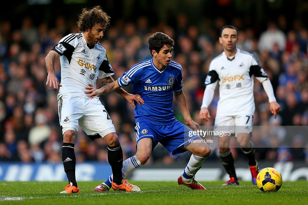 Oscar of Chelsea and Jose Alberto Canas of Swansea City battle for the ball during the Barclays Premier League match between Chelsea and Swansea City at Stamford Bridge on December 26, 2013 in London, England.