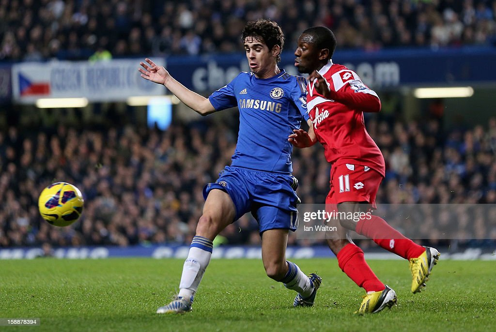 Oscar of Chelsea and Shaun Wright Phillips of Queens Park Rangers battle for the ball during the Barclays Premier League match between Chelsea and Queens Park Rangers at Stamford Bridge on January 2, 2013 in London, England.