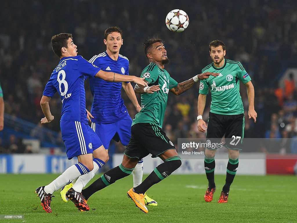 Oscar of Chelsea battles with Kevin-Prince Boateng of Schalke during the UEFA Champions League Group G match between Chelsea FC and FC Schalke 04 on September 17, 2014 in London, United Kingdom.