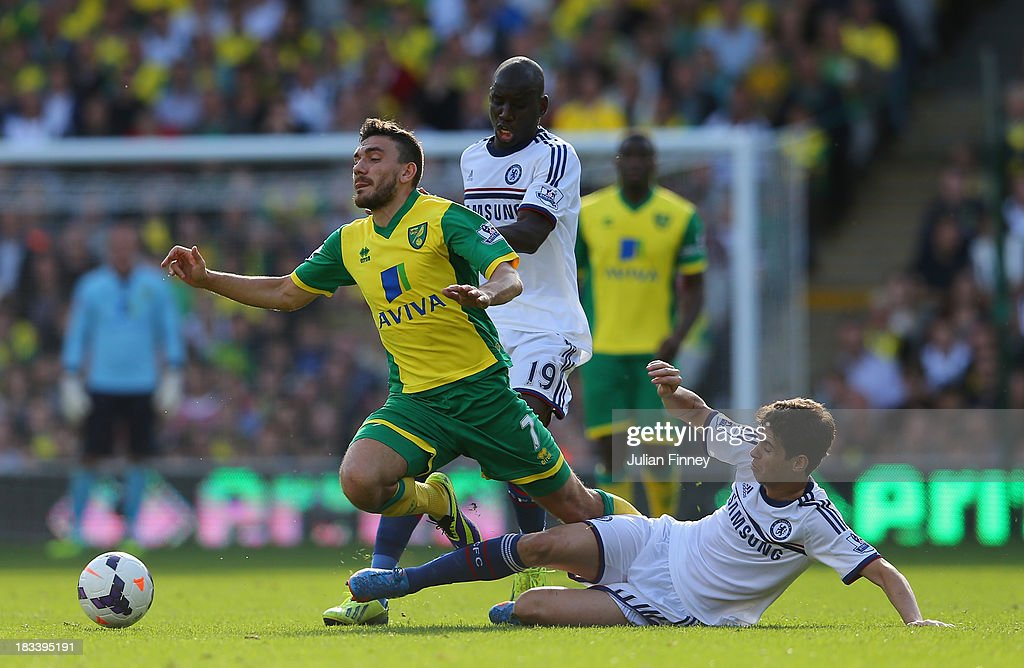 Oscar of Chelsea brings down <a gi-track='captionPersonalityLinkClicked' href=/galleries/search?phrase=Robert+Snodgrass&family=editorial&specificpeople=5488953 ng-click='$event.stopPropagation()'>Robert Snodgrass</a> of Norwich City during the Barclays Premier League match between Norwich City and Chelsea at Carrow Road on October 6, 2013 in Norwich, England.