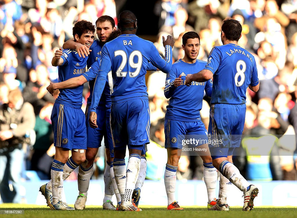 Oscar of Chelsea (L) celebrates after scoring their third goal during the FA Cup Fourth Round Replay between Chelsea and Brentford at Stamford Bridge on February 17, 2013 in London, England.