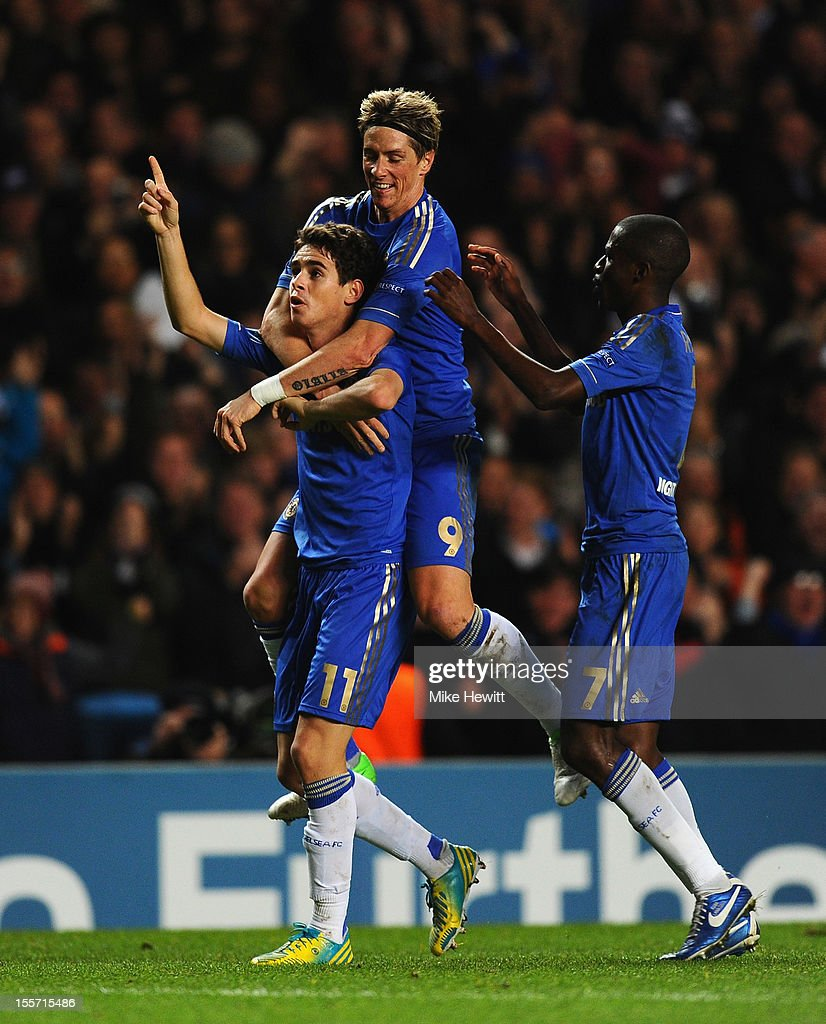 Oscar of Chelsea celebrates his goal with <a gi-track='captionPersonalityLinkClicked' href=/galleries/search?phrase=Fernando+Torres&family=editorial&specificpeople=194755 ng-click='$event.stopPropagation()'>Fernando Torres</a> and Ramires during the UEFA Champions League Group E match between Chelsea and Shakhtar Donetsk at Stamford Bridge on November 7, 2012 in London, England.