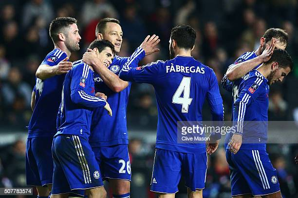 Oscar of Chelsea celebrates scoring his hat trick goal with John Terry during the Emirates FA Cup Fourth Round match between Milton Keynes Dons and...