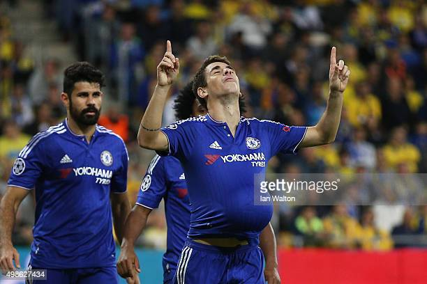 Oscar of Chelsea celebrates scoring his teams third goal during the UEFA Champions League Group G match between Maccabi TelAviv FC and Chelsea FC at...