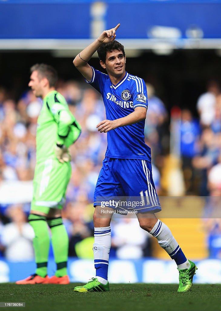 Oscar of Chelsea celebrates scoring the opening goal during the Barclays Premier League match between Chelsea and Hull City at Stamford Bridge on August 18, 2013 in London, England.
