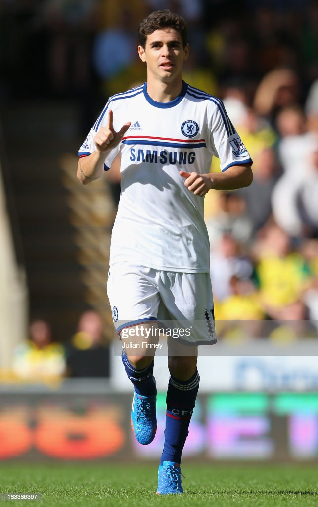 Oscar of Chelsea celebrates scoring the opening goal during the Barclays Premier League match between Norwich City and Chelsea at Carrow Road on October 6, 2013 in Norwich, England.