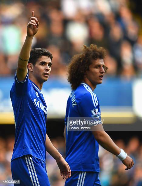 Oscar of Chelsea celebrates scoring their fifth goal with David Luiz of Chelsea during the Barclays Premier League match between Chelsea and Arsenal...