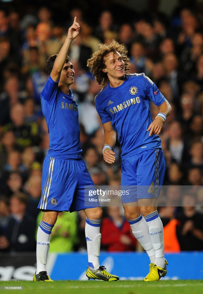 Oscar of Chelsea celebrates scoring their first goal with <a gi-track='captionPersonalityLinkClicked' href=/galleries/search?phrase=David+Luiz&family=editorial&specificpeople=4133397 ng-click='$event.stopPropagation()'>David Luiz</a> of Chelsea during the UEFA Champions League Group E match between Chelsea and Juventus at Stamford Bridge on September 19, 2012 in London, England.