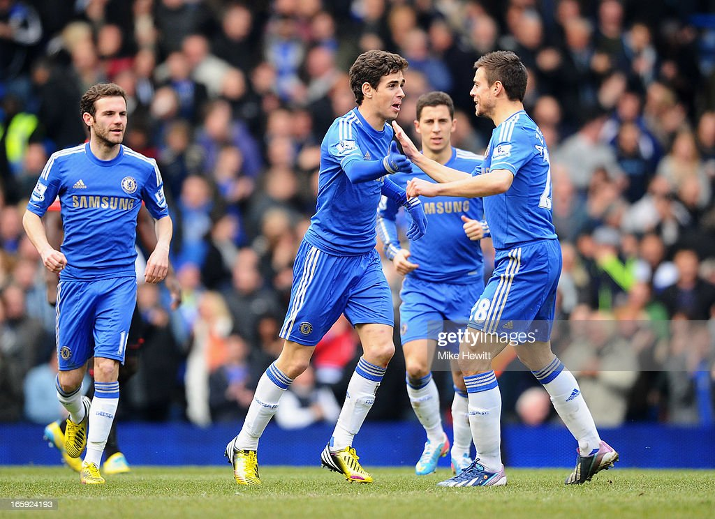 Oscar (C) of Chelsea celebrates the equalising goal, an own goal by Matthew Kilgallon of Sunderland with Cesar Azpilicueta (R) during the Barclays Premier League match between Chelsea and Sunderland at Stamford Bridge on April 7, 2013 in London, England.
