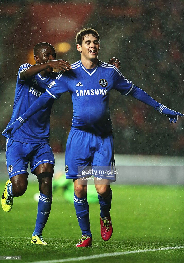Oscar of Chelsea celebrates with teammate Ramires after scoring his team's third goal during the Barclays Premier League match between Southampton and Chelsea at St Mary's Stadium on January 1, 2014 in Southampton, England.
