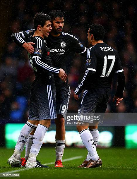 Oscar of Chelsea celebrates with teammates Pedro and Diego Costa of Chelsea after scoring the opening goal during the Barclays Premier League match...
