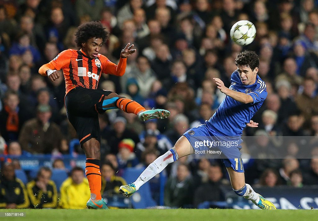 Oscar of Chelsea challenges Willian of Shakhtar Donetsk during the UEFA Champions League Group E match between Chelsea and Shakhtar Donetsk at Stamford Bridge on November 7, 2012 in London, England.
