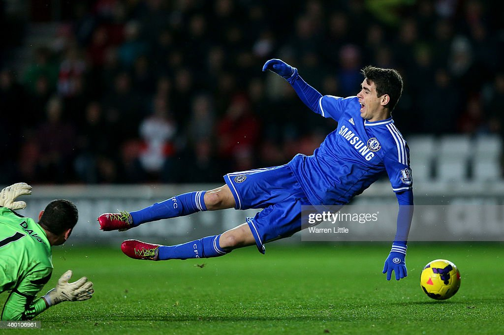 Oscar of Chelsea goes down in the area after seemingly making contact with goalkeeper Kelvin Davis of Southampton during the Barclays Premier League match between Southampton and Chelsea at St Mary's Stadium on January 1, 2014 in Southampton, England. Oscar of Chelsea was later shown the yellow card for simulation.
