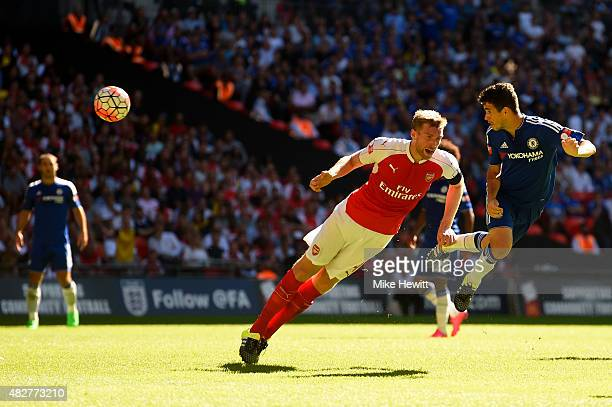 Oscar of Chelsea heads towards goal under pressure from Per Mertesacker of Arsenal during the FA Community Shield match between Chelsea and Arsenal...