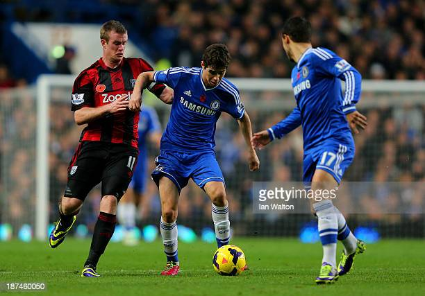 Oscar of Chelsea is challenged by Chris Brunt of West Brom during the Barclays Premier League match between Chelsea and West Bromwich Albion at...