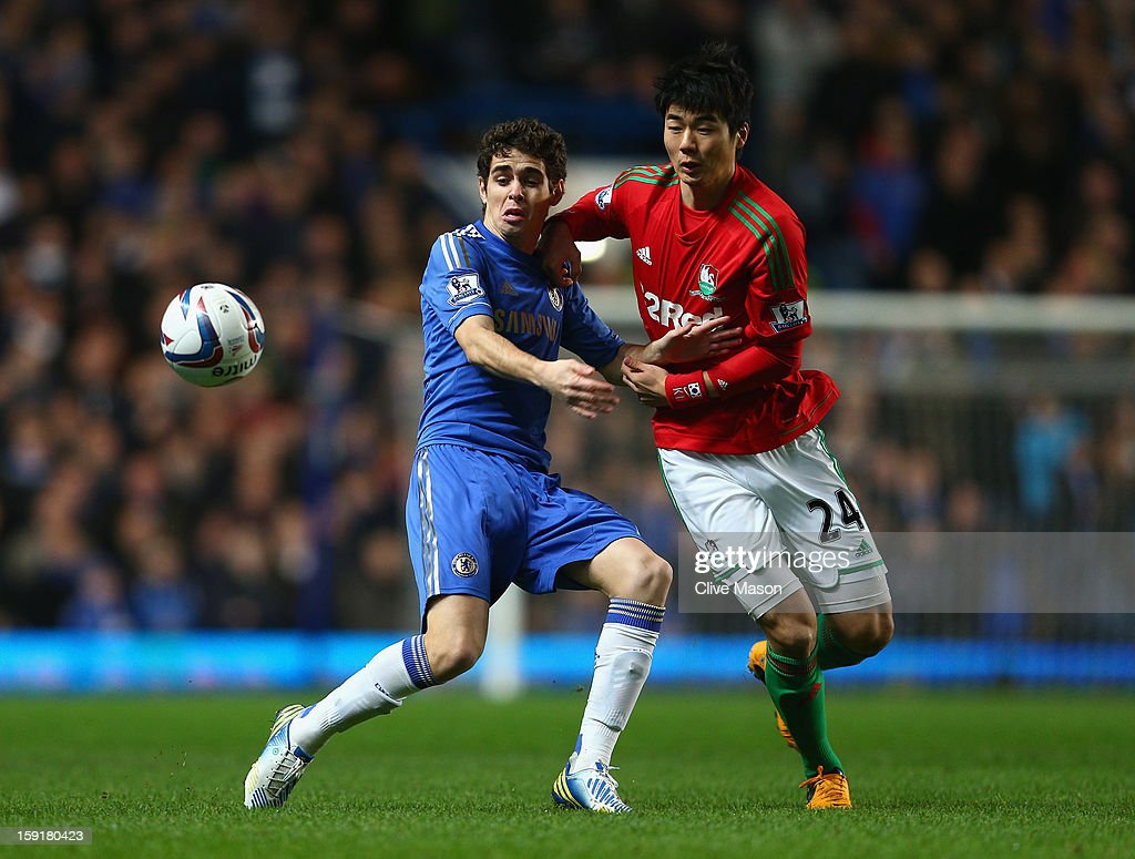 Oscar of Chelsea is challenged by Ki Sung-Yueng of Swansea City during the Capital One Cup Semi-Final first leg match between Chelsea and Swansea City at Stamford Bridge on January 9, 2013 in London, England.