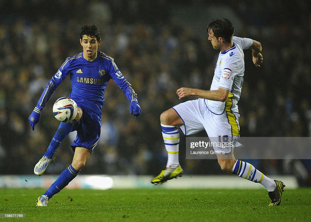 Oscar of Chelsea is challenged by Michael Tonge of Leeds United during the Capital One Cup Quarter-Final match between Leeds United and Chelsea at Elland Road on December 19, 2012 in Leeds, England.