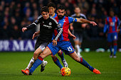 Oscar of Chelsea is fouled by Mile Jedinak of Crystal Palace during the Barclays Premier League match between Crystal Palace and Chelsea at Selhurst...