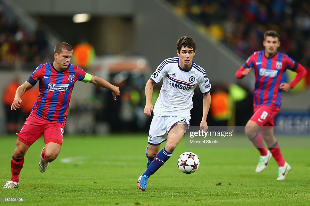 Oscar (C) of Chelsea is tracked by <a gi-track='captionPersonalityLinkClicked' href=/galleries/search?phrase=Alexandru+Bourceanu&family=editorial&specificpeople=6597771 ng-click='$event.stopPropagation()'>Alexandru Bourceanu</a> (L) of Steaua Bucurestiduring the UEFA Champions League Group E Match between FC Steaua Bucuresti and Chelsea at the National Arena Stadium on October 1, 2013 in Bucharest, Romania.