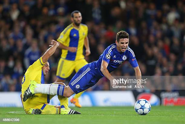Oscar of Chelsea is tripped by Tal Ben Haim of Maccabi Tel Aviv during the UEFA Champions League match between Chelsea and Maccabi TelAviv at...