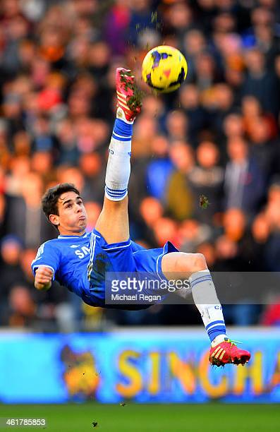 Oscar of Chelsea performs an overhead kick during the Barclays Premier League match between Hull City and Chelsea at KC Stadium on January 11 2014 in...