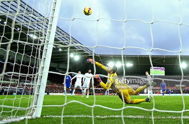 Oscar of Chelsea scores his team's fourth goal past Lukasz Fabianski of Swansea City during the Barclays Premier League match between Swansea City...