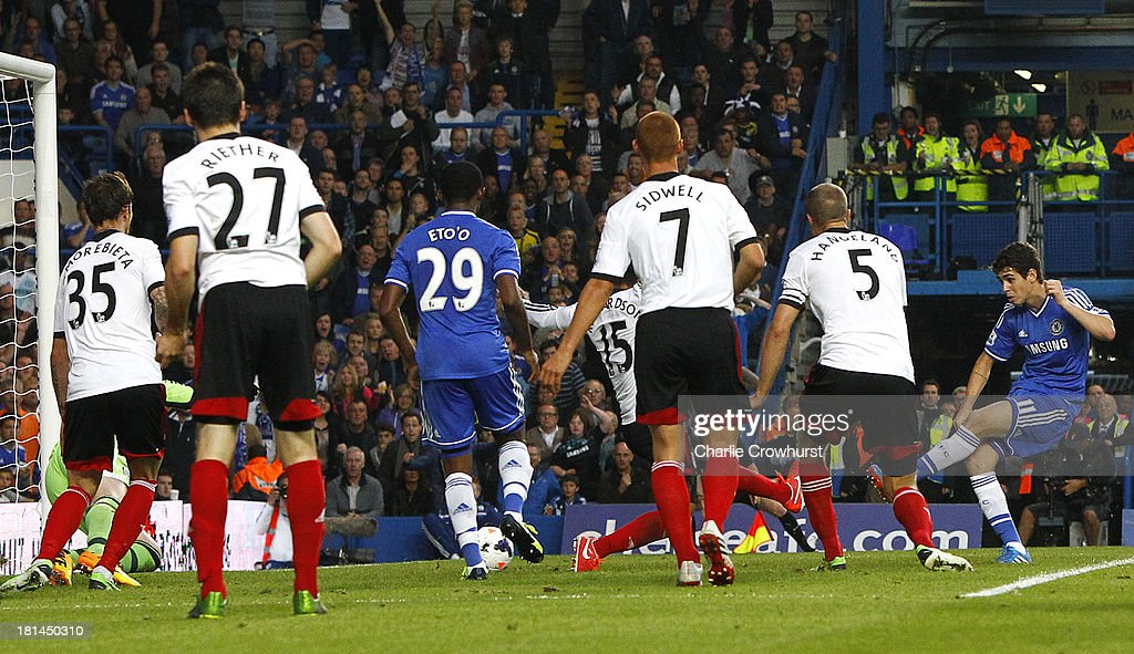 Oscar of Chelsea scores the first goal of the game during the Barclays Premier League match between Chelsea and Fulham at Stamford Bridge on September 21, 2013 in London, England.