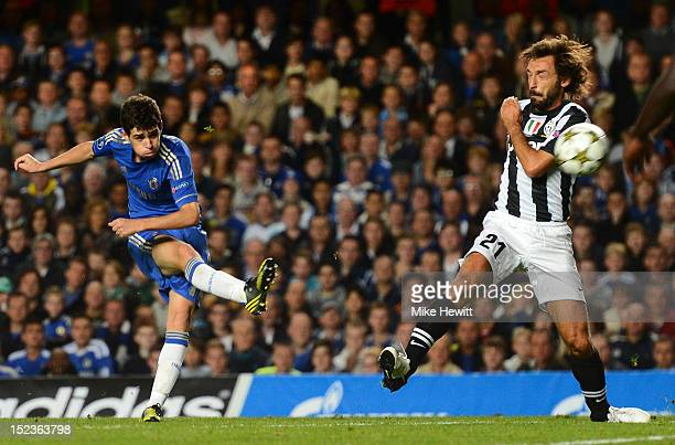 Oscar of Chelsea scores their second goal during the UEFA Champions League Group E match between Chelsea and Juventus at Stamford Bridge on September...