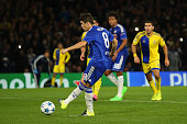 Oscar of Chelsea scores their second goal from the penalty spot during the UEFA Chanmpions League group G match between Chelsea and Maccabi TelAviv...