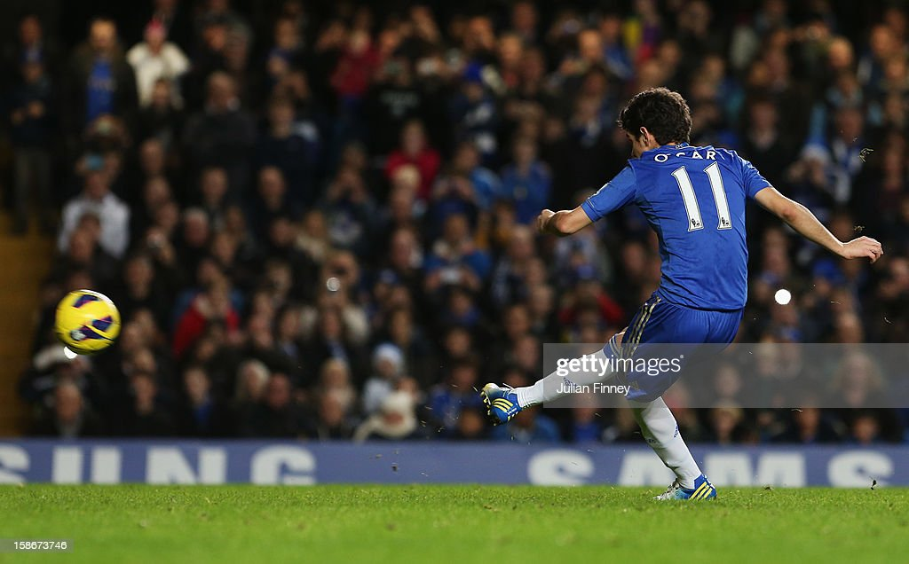 Oscar of Chelsea shoots from the penalty spot to score their sixth goal during the Barclays Premier League match between Chelsea and Aston Villa at Stamford Bridge on December 23, 2012 in London, England.