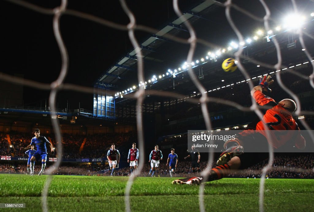 Oscar of Chelsea shoots from the penalty spot to score their sixth goal past <a gi-track='captionPersonalityLinkClicked' href=/galleries/search?phrase=Brad+Guzan&family=editorial&specificpeople=662127 ng-click='$event.stopPropagation()'>Brad Guzan</a> of Aston Villa during the Barclays Premier League match between Chelsea and Aston Villa at Stamford Bridge on December 23, 2012 in London, England.