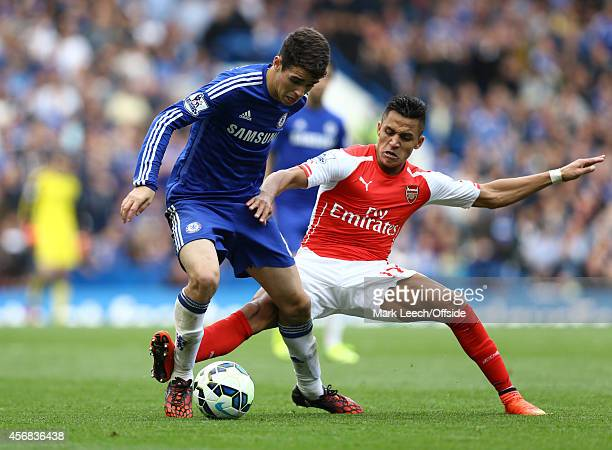 Oscar of Chelsea tangles with Alexis Sanchez of Arsenal during the Premier League match between Chelsea and Arsenal at Stamford Bridge on October 5...