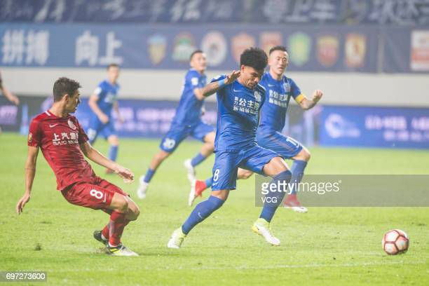 Oscar of Shanghai SIPG and Junior Urso of Guangzhou Fuli compete for the ball during the 13th round match of 2017 Chinese Football Association Super...