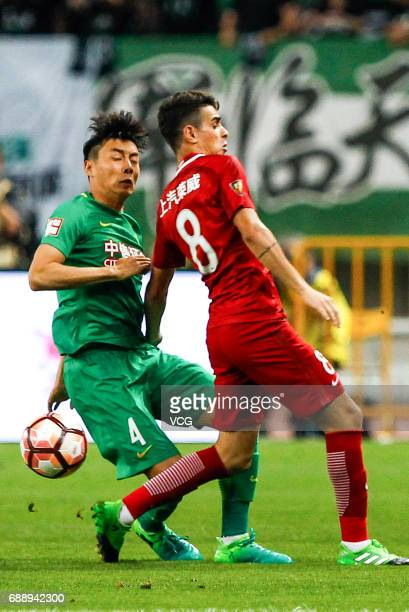Oscar of Shanghai SIPG and Li Lei of Beijing Guoan compete for the ball during the 11th round match of 2017 Chinese Football Association Super League...